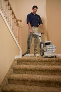 Chem-Dry tech cleaning carpet on stair landing