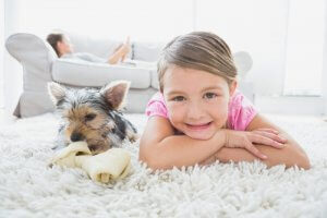 little girl and dog lying on carpet cleaned by Chem-Dry of Santa Clarita Valley